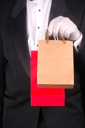 Man in Tuxedo Holding Two Small Shopping Bags - torso shot Stock Photo - 2995304