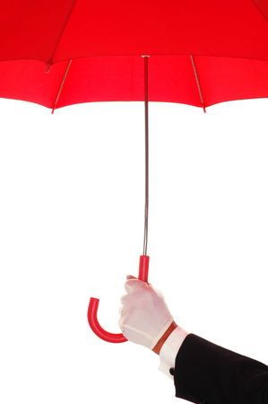 Man in Tuxedo Holding an Open Red Umbrella isolated over white Stock Photo - 2995262