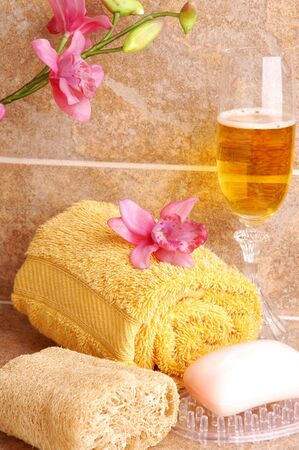 Bath Accessories with Champagne and Orchids on Tile photo