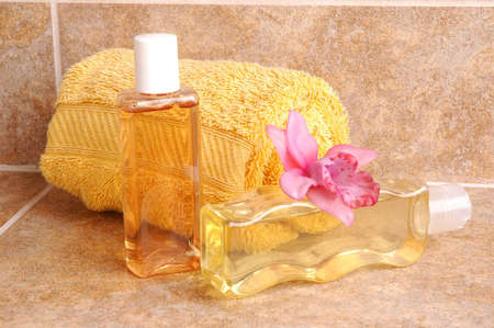 bodywash: Bath Accessories with Towel and Orchid on Tile
