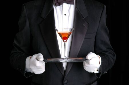 Butler Holding a Cocktail on Silver Tray Stock Photo - 3185769