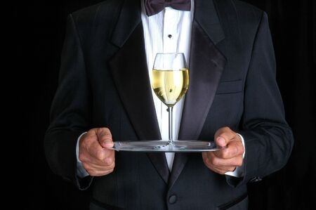 Man Holding a Glass of White Wine on a Tray photo
