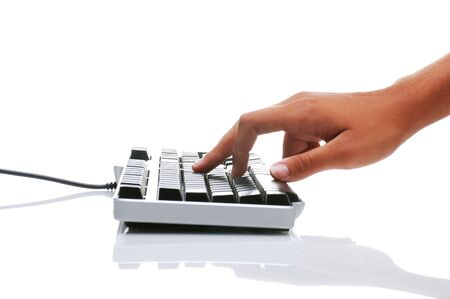 Womans Hand on Computer Keyboard, isolated over white with reflection in tabletop Stock Photo - 3284256