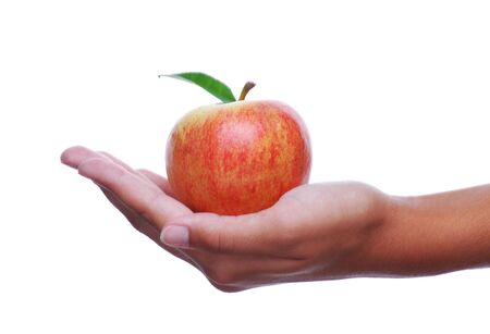 womans: Womans Outstretched Hand Holding an Apple isolated over white