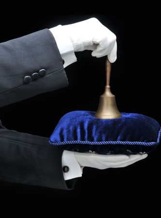 valet: Butler holding a velvet pillow and a bell - hands and arms only