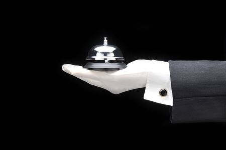 cuff link: Butlers outstretched hand and arm with call bell