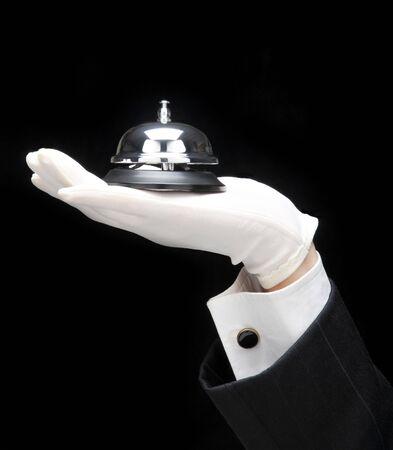 cloches: Butlers main et du bras avec la cloche d'appel Banque d'images