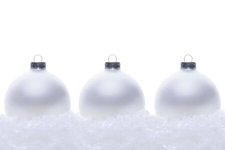 Three silver christmas tree ornaments isolated on white