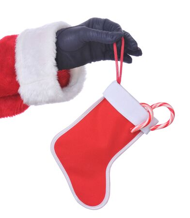 Santa Hanging Stocking with Candy Canes isolated over white Stock Photo - 3948594
