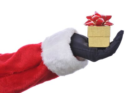Santas Hand and Arm with Gold Gift Box isolated over white Stock Photo - 3948589