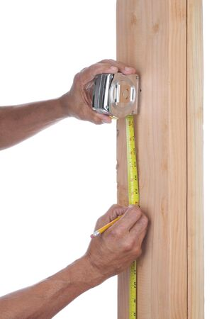 Carpenter measuring boards isolatd over white background - hands and arms only Stock Photo