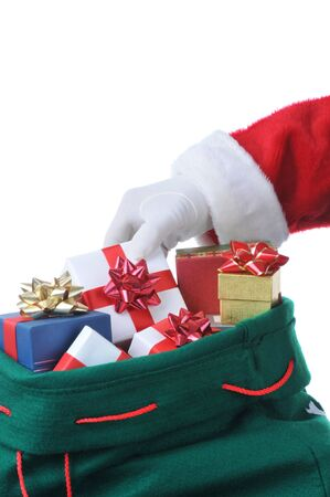 Santa reaching into his bag of christmas presents isolated over white Stock Photo - 4006190