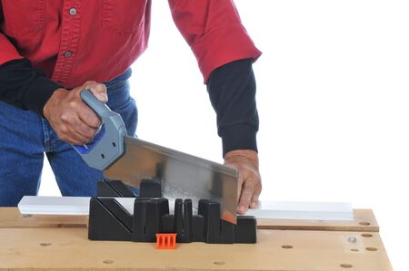 miter: Construction Worker using a saw and miter box - isolated over white