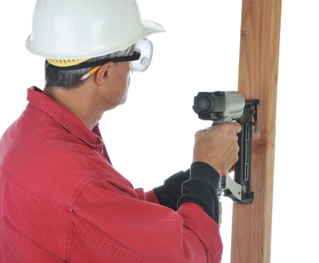 Construction Worker using a Nail Gun - isolated over white