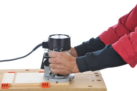 carpenter vise: Woodworker using a router - hands and arms only isolated over white Stock Photo