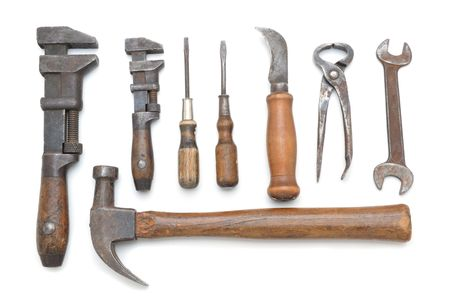 Group of antique hand tools on white background with slight shadows photo