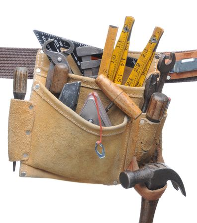 Tool Belt Stuffed with assorted hand tools isolated over white Stock Photo