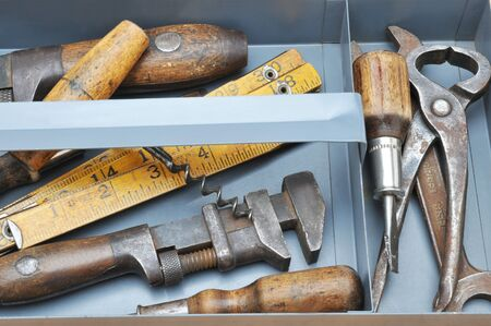 Closeup of a tool tray with assorted old tools photo