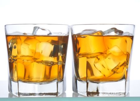 barware: Two Whiskeys on glass bar counter isolated on white Stock Photo