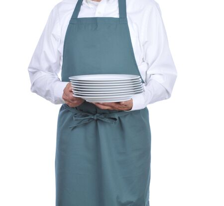busboy: Busboy carrying a stack of plates - torso only Stock Photo