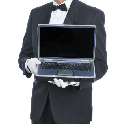 torso only: Butler in tuxedo holding a laptop computer - torso only