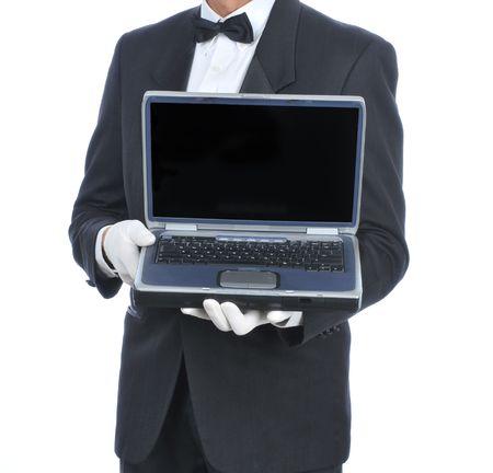 meseros: Esmoquin de mayordomo en la celebraci�n de un ordenador port�til - torso s�lo
