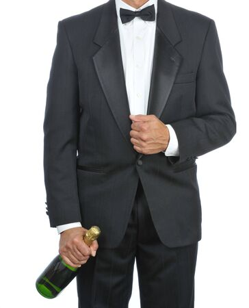 Waiter holding champagne bottle at his side isolated on white background Stock Photo - 4174811