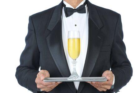 gastfreundschaft: Mann in Tuxedo Champagne Fl�te auf Fach isoliert �ber wei� Lizenzfreie Bilder