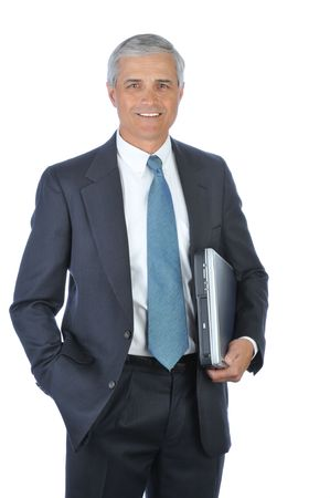 Businessman carrying Laptop Under His arm with hand in pocket isolated on white