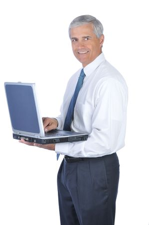 Smiling Businessman Hlding an open Laptop Computer isolated on white Stock Photo - 4319776