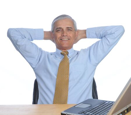 Businessman Siting at His Desk with hands behind his head Stock Photo - 4448996