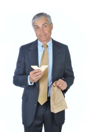 Businessman holding sac brun et blanc sandwich isolés Banque d'images - 4449013