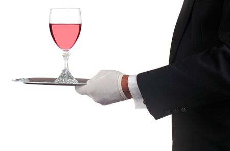 Man in Tuxedo Serving Champagne Glass isolated over white photo