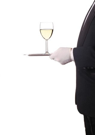 Glass of Chardonnay Wine Being Served by Waiter on Silver Tray isolated over white photo