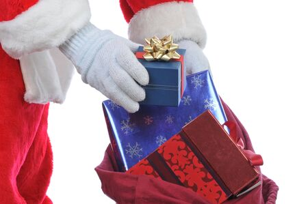 Santa Claus Hands and Bag with Presents Close up isolated on white photo