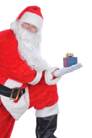 Santa Claus Holding a Christmas Present in his hand - foot on stool leaning on leg