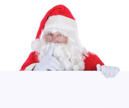 Santa Claus with Blank Sign isolated on white making shh sign with finger in front of face photo
