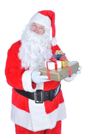 st nick: Santa Claus Holding several wrapped Christmas presents isolated on white Stock Photo
