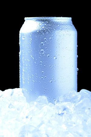Aluminum Drink Can with water droplets Standing in a bed of ice - black background and cool tones