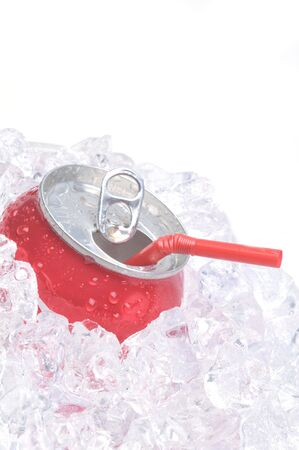 Close Up of Red Soda Can in Ice with Drinking Straw isolated on white photo