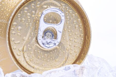 pulltab: Close Up of a Golden Soda Can with Pull Tab and Condensation white background copyspace