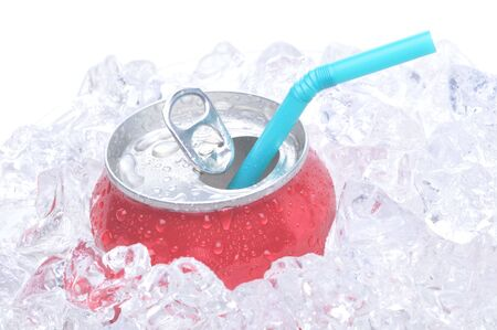 pulltab: Single soda can in ice with drinking straw white background copy space