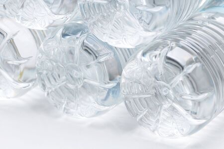 Close up of several Plastic Water Bottles with cool tones