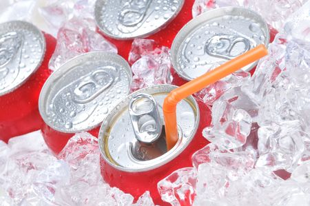 pulltab: Close Up of Soda Cans in Ice with Straw and Condensation