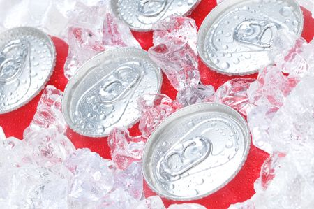 Close Up of Soda Cans in Ice with Condensation photo