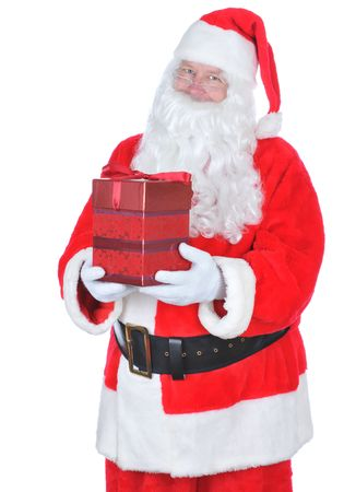 Santa Claus Holding a Red Christmas Present isolated on white Stock Photo - 5202830