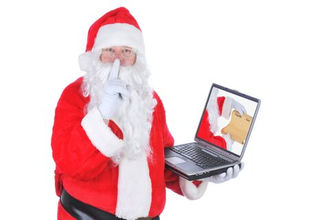 Santa Claus With naughty List on Laptop isolated on white photo