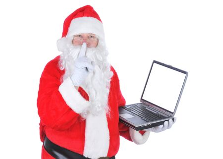 Santa Claus With Blank Screen on Laptop isolated on white photo