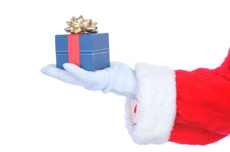 st nick: Santa Claus Outstretched Hand Holding Gift Box isolated on white