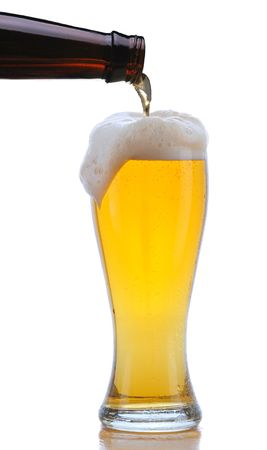 pilsner: Glass of Beer being Poured from Bottle with Foam Drip and Reflection isolated on white Stock Photo